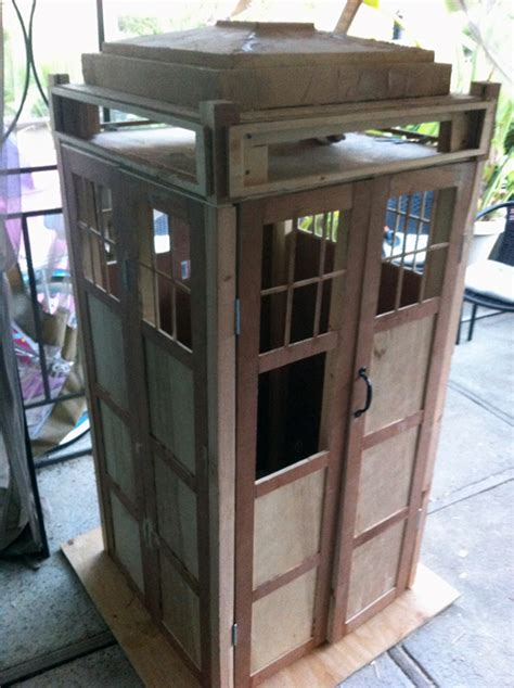 this tardis bookshelf diy is actually bigger on the inside