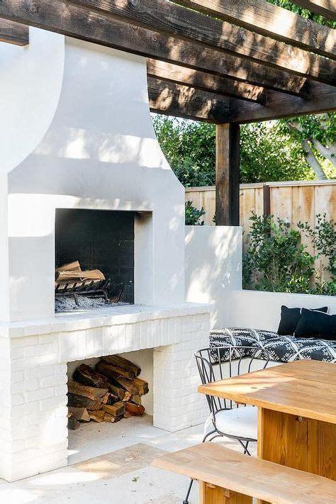 dark stained pergola  white fireplace  fixed