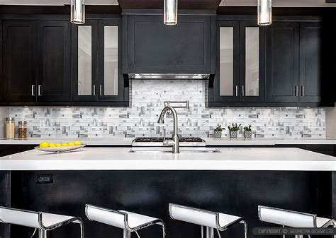 brown cabinets glass metal and marble backsplash tile