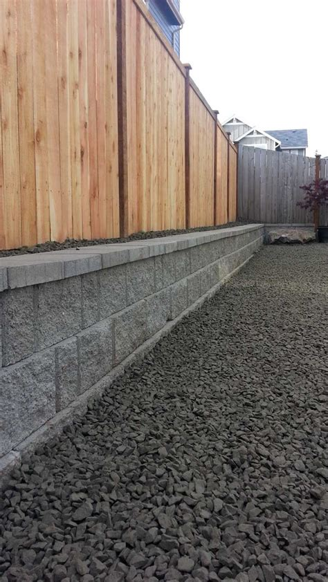 the rear of the property now has a 2 foot high retaining wall which allowed us to regrade the