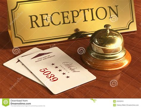 service bell and cardkeys on hotel reception desk stock