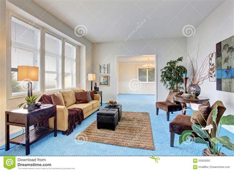 georgous living room with bright blue carpet stock photo