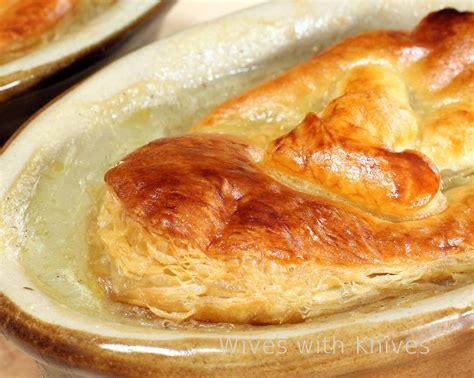 Chicken Pastry chicken pot pies with knives