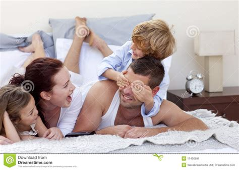 fun in bed happy young family having fun in bed stock image image