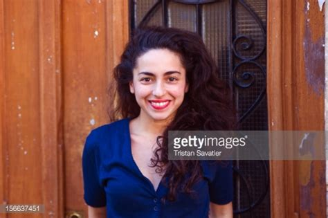 picture of mature italian woman with curly black hair young italian woman with long black curly hair stock photo