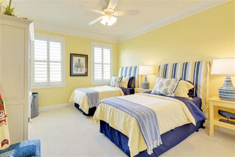 yellow paint in bedroom cheerful beach cottage with turquoise color scheme home