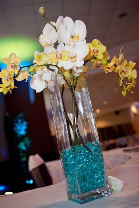 White and Yellow Orchids. Teal water beads. Square vases