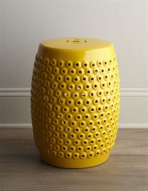 horchow now yellow pierced ceramic stool saved by chic n