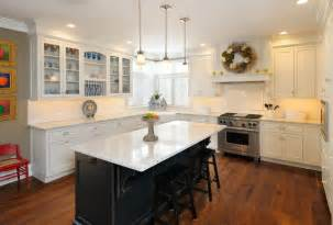 white kitchen with black island traditional kitchen