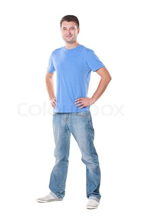 standing sideways in blue t shirt standing white stock photo