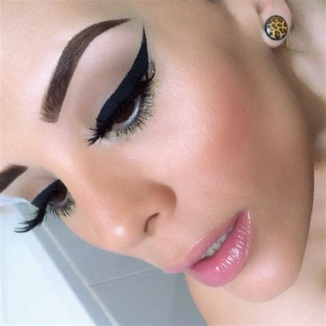 Rowena And Arianna brown dramatic winged eyeliner pink