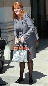 Name The Bag Fergie by Fergie Displays S Faces On Handbag As She