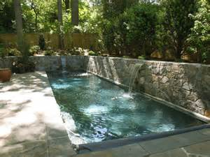 Backyard Pools With Retaining Walls Pool With Sheer Descent Waterfalls And Retaining Walls
