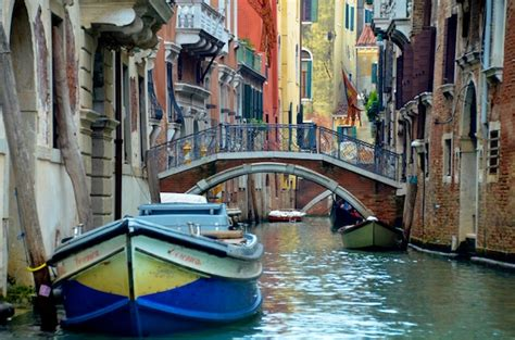 small boat venice travel photo canal in venice italy the roaming boomers