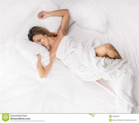 naked woman in bed laying in bed or lying in bed sensual woman laying in bed stock photo image 55055904