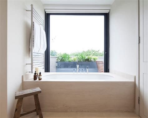 bathtub window bathroom windows that pull in light and add privacy too
