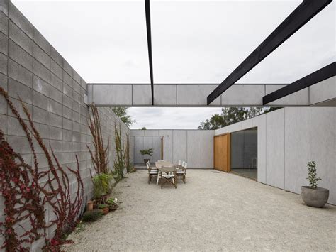 room 11 architects a courtyard for outdoor living helps a hobart family to downsize