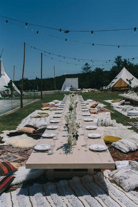 picture   simple picnic setting  neutral florals lots  carpets  pillows  teepee