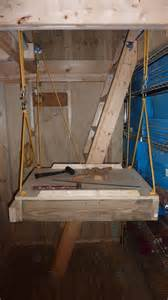 Stair Pulley System by Attach Stairs To Door Panel Before Enabling Pulley System