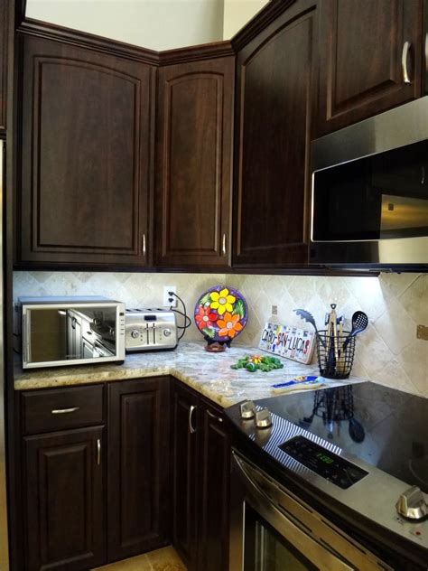 hang microwave under cabinet under cabinet lighting backless slide in range and
