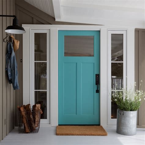 turquoise front door cottage home exterior