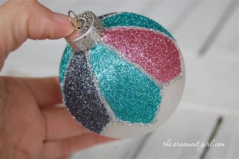 decorate a plain christmas ornament with glitter