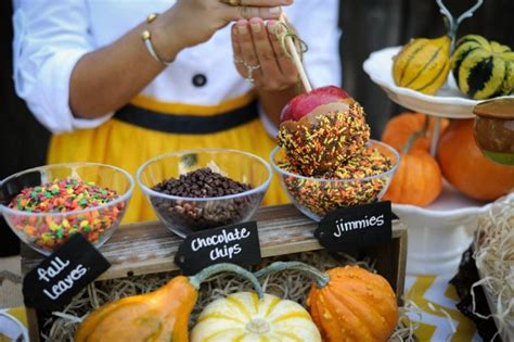 caramel apple bar toppings line up to fill up at one of these 12 party perfect food