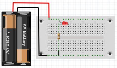 Lu Led Yang Panjang merangkai flip flop pada papan rangkai non solder breadboard sebagai project uji rangkaian