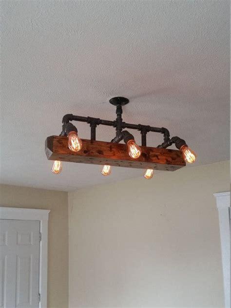 black pipe light fixture wood beam light chandelier industrial pipe lighting