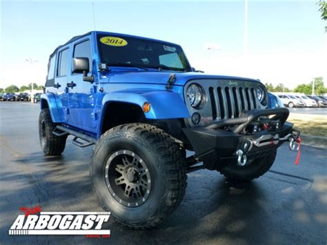 Jeep Is Owned By Pre Owned 2014 Jeep Wrangler Lifted Unlimited Sport 4d