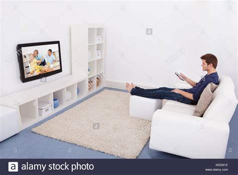 watching tv on couch woman watching tv alone stock photos woman watching tv
