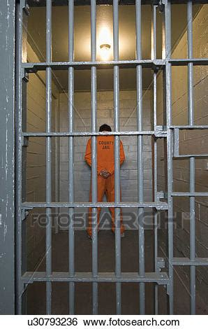 stock images of prisoner standing in prison cell u30793236