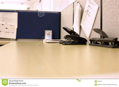 office desk with puncher and stapler stock