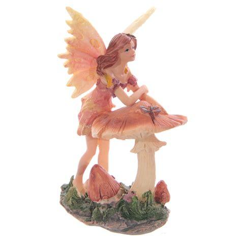 sweet flower fairy leaning on toadstool 11cm 9426