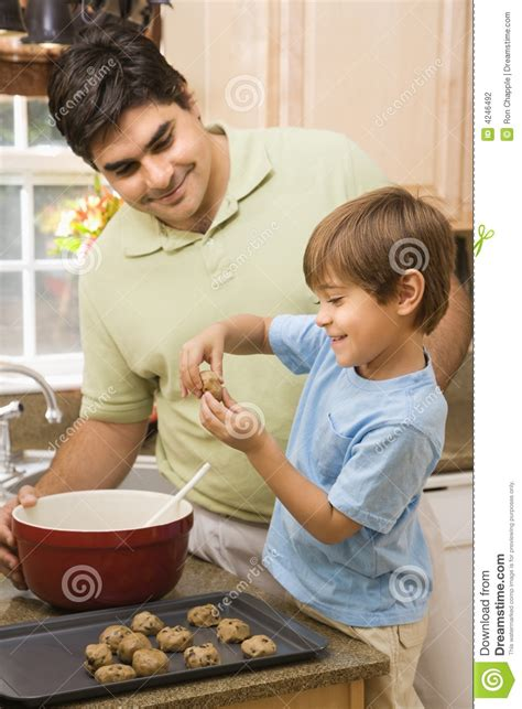 Free Kitchen Design Program by Dad And Son Making Cookies Stock Photography Image 4246492