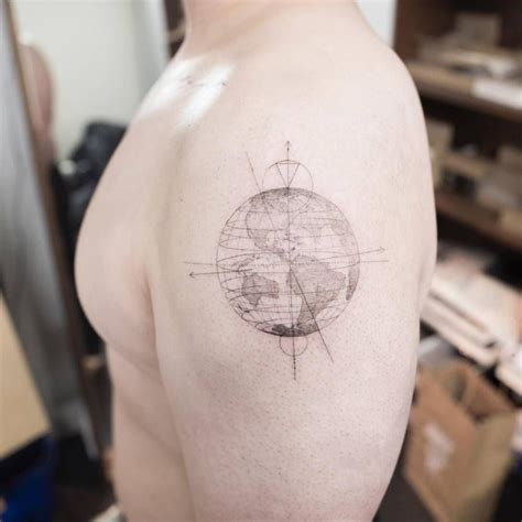 earth tattoo single needle planet earth on the left shoulder