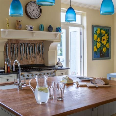blue pendant lights kitchen yellow kitchen with blue pendant lighting and island