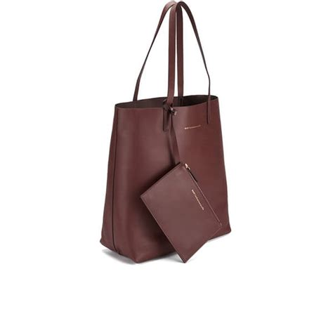Dakota Johnson Tote Bag want les essentiels s logan vertical tote bag