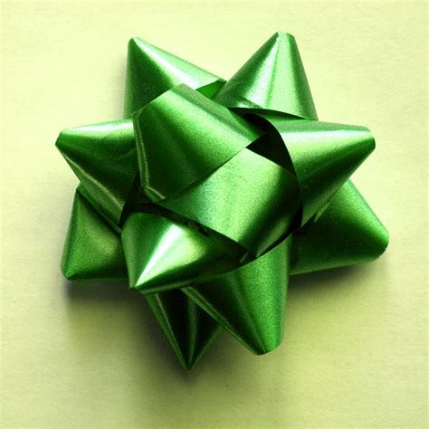 How To Make A Bow With Wrapping Paper - green bow on yellow wrapping paper picture free