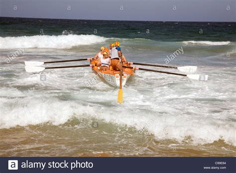 rowing boats australia crew of a traditional australian lifeboat surf rescue boat