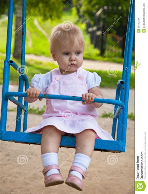 swinging videos free little girl swinging in a playground royalty free stock