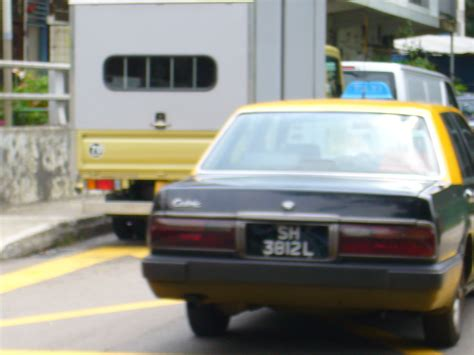 File Nissan Cedric Y31 Yellow Top Taxi Singapore