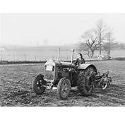 A Land Army Girl Using Fordson Tractor To Plough