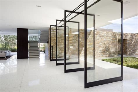 glass walls size matters large pivot doors know how to stand out