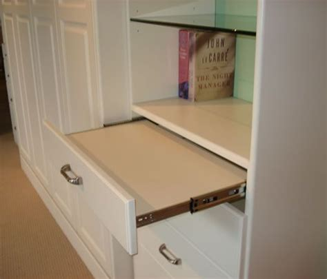 pull out table between washer and dryer slide out tray maybe as a folding table between stacked
