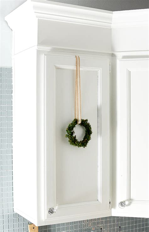 how to hang kitchen cabinet doors christmas in the kitchen with mini wreaths it all