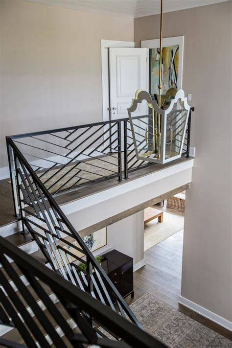 contemporary staircase features pendant light metal