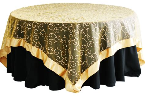 gold table overlay simply weddings linen rentals organza swirl