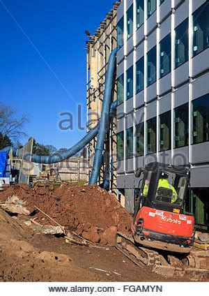 men on construction site and mechanical diggers