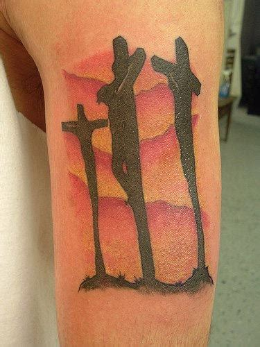 three cross tattoo on muscle